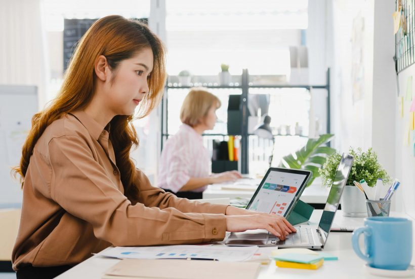 young-asia-businesswoman-entrepreneur-social-distancing-new-normal-situation-virus-prevention-while-using-laptop-computer-tablet-back-work-office